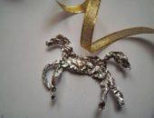 Миниатюра к статье Поделки с детьми на Новый год 2014: серебряная лошадка из фольги